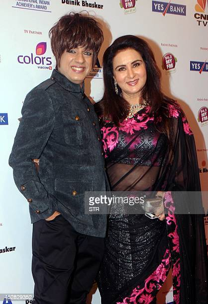 Indian Bollywood film actress Poonam Dhillon and dress designer Rohit Varma attend the 'IIAA Awards 2014' in Mumbai on July 27 2014 AFP PHOTO