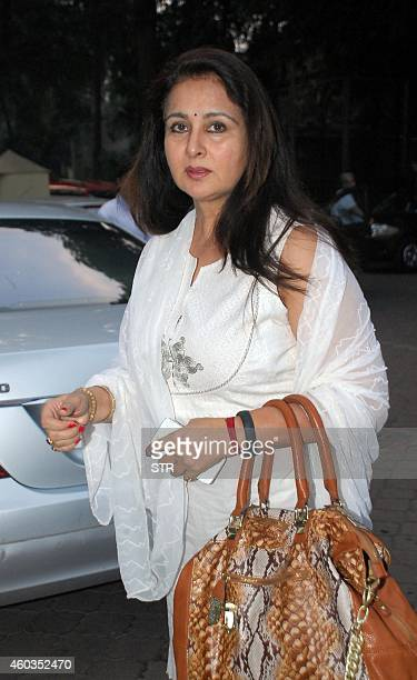 Indian Bollywood film actress Poonam Dhillon attends a prayer meeting for Bhajan maestro Anup Jalotas late wife Medha Jalota in Mumbai on December 11...
