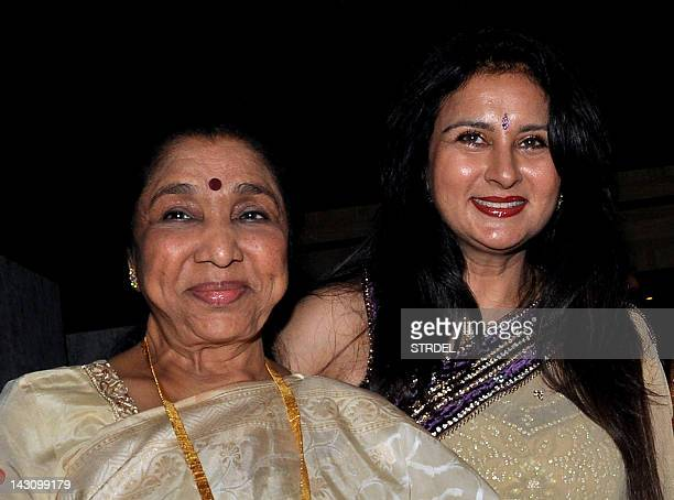 Indian Bollywood film actress Poonam Dhillon poses with playback singer Asha Bhosle during her birthday celebration in Mumbai on April 18 2012 AFP...