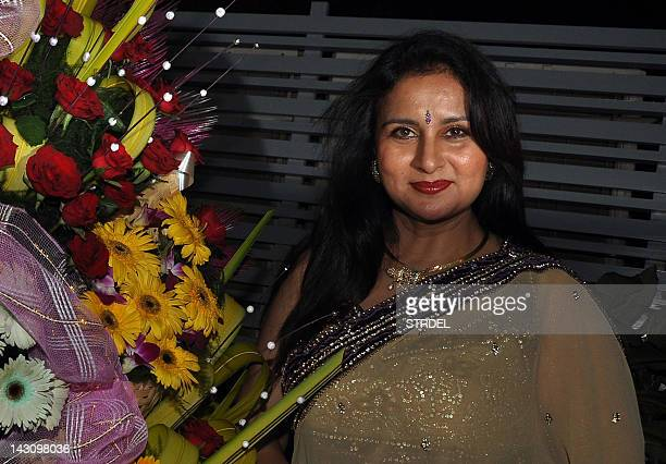 Indian Bollywood film actress Poonam Dhillon smiles during her birthday celebration in Mumbai on April 18 2012 AFP PHOTO/ STR