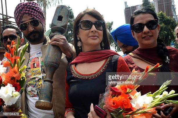 Indian Bollywood film actress Preeti Jhangiani Punjabi singer and actor Jassi Jasraj along with film producer Prabhjot Kaur arrive for a press...