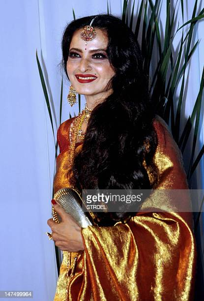 Indian Bollywood film actress Rekha poses during the wedding reception ceremony of film actress Esha Deol and husband Bharat Takhtani in Mumbai on...