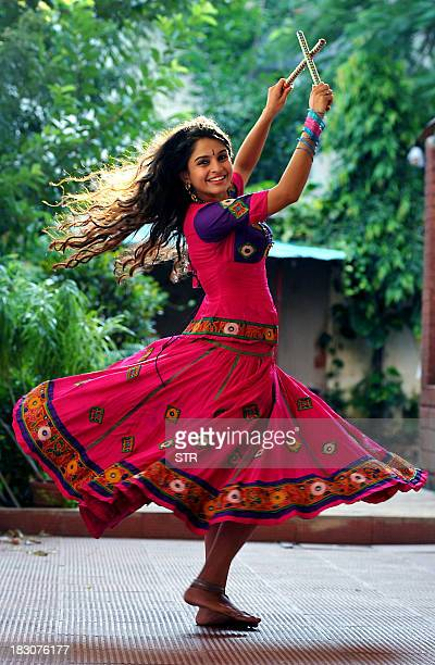 Indian Bollywood film actress Sheena Shahabadi poses during a photo shoot of the 'Dandiya Raas' traditional folk dance performed in Hindu Goddess...
