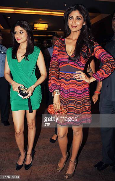 Indian Bollywood film actress Shilpa Shetty and sister Shamita Shetty attend the Lakme Fashion Week Winter/Festival 2013 in Mumbai on August 24 2013...