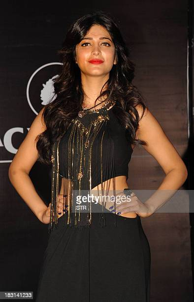 Indian Bollywood film actress Shruti Haasan attends the Showstoppers 'Blackberry's Sharp Nights Progressive'fashion show in Mumbai on October 4 2013...