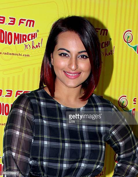 Indian Bollywood film actress Sonakshi Sinha poses during the promotion of the Hindi film 'Tevar' at 983 FM studios in Mumbai on December 10 2014 AFP...