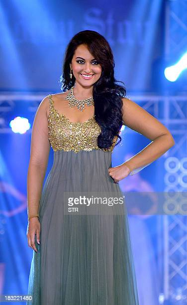 Indian Bollywood film actress Sonakshi Sinha walks the ramp during a fashion show at the 'India Bullion and Jewellery Awards' in Mumbai on October 5...