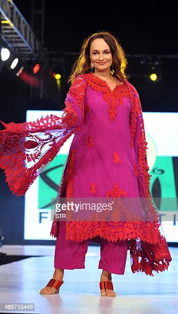 Indian Bollywood film actress Soni Razdan Bhatt showcases a creation by designer Salim Asgarally during the fifth edition of the Smile Foundation...