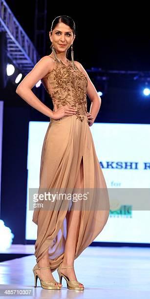 Indian Bollywood film actress Soumya Tondon showcases a creation by designer Sonaakshi Raaj during the fifth edition of the Smile Foundation charity...