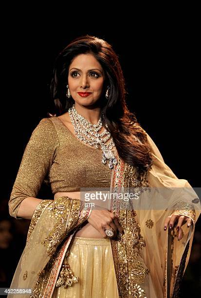 Indian Bollywood film actress Sridevi presents a creation during the India International Jewellery Week 2014 in Mumbai on July 16 2014 AFP PHOTO
