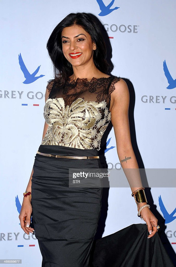 Indian Bollywood film actress Sushmita Sen poses during the 'Grey Goose Style Du Jour' Spring-Summer collection fashion show in Mumbai on December 10, 2013.