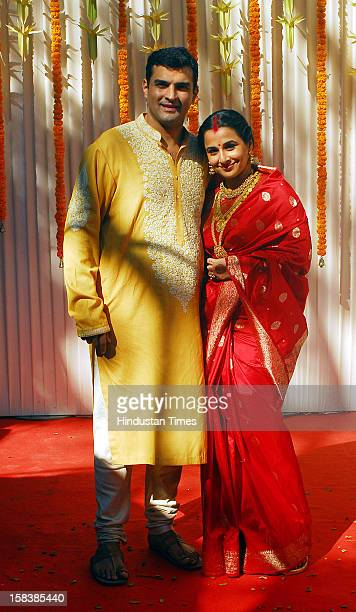 Indian bollywood film actress Vidya Balan and her husband Siddharth Roy Kapur pose together during their wedding ceremony at the Green Mile bungalow...