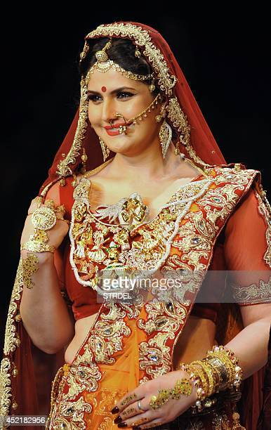 Indian Bollywood film actress Zarine Khan presents a creation during the India International Jewellery Week 2014 in Mumbai on July 15 2014 AFP...