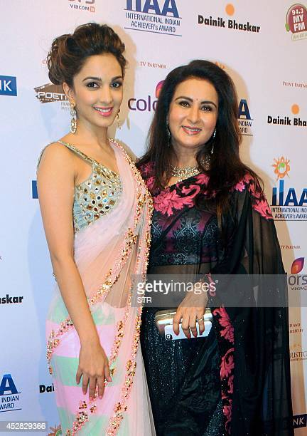 Indian Bollywood film actresses Kiara Advani and Poonam Dhillon attend the 'IIAA Awards 2014' in Mumbai on July 27 2014 AFP PHOTO