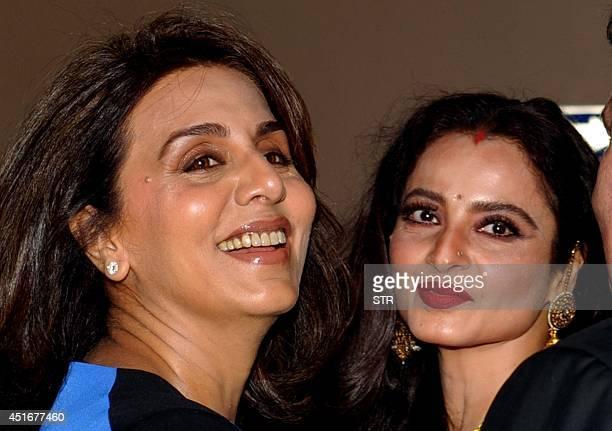 Indian Bollywood film actresses Neetu Singh and Rekha attend the premier of Hindi film 'Lekar Hum Deewana Dil' in Mumbai on July 3 2014 AFP PHOTO