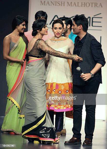 Indian Bollywood film actresses Priyanka Chopra Kajol Devgan and Karishma Kapoor showcase creations by designer Manish Malhotra during a fashion show...