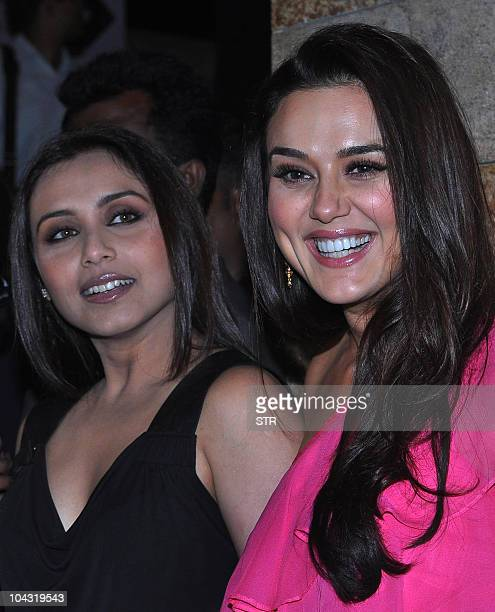 Indian Bollywood film actresses Rani Mukharjee and Preity Zinta attend Indian designer Manish Malhotra's show during the fourth day of the Lakme...