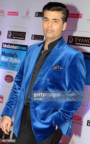 Indian Bollywood film director and producer Karan Johar poses as he attends the HT Mumbai's Most Stylish Awards 2015 ceremony in Mumbai late March...