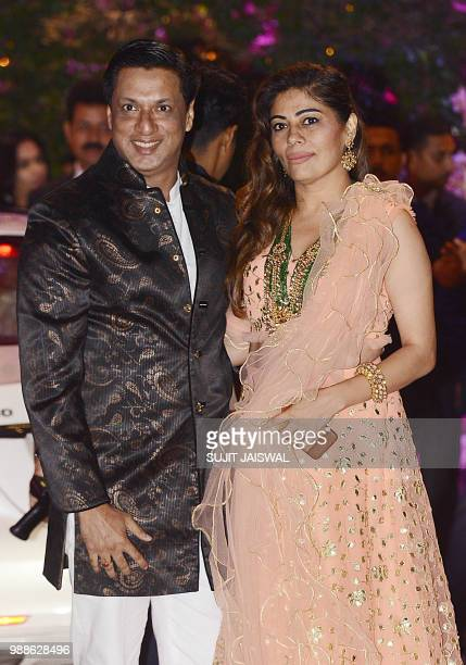 Indian Bollywood film director and producer Madhur Bhandarka poses for a picture with his wife as they attend the preengagement party of India's...