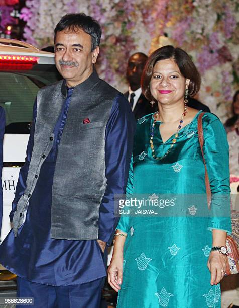 Indian Bollywood film director and producer Rajkumar Manjeet Hirani poses for a picture with his wife as they attend the preengagement party of...