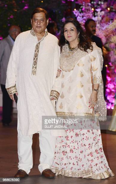 Indian Bollywood film director David Dhawan poses for a picture with his wife Karuna as they attend the preengagement party of India's richest man...