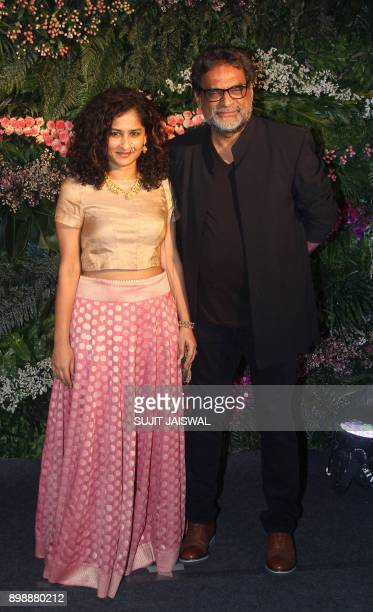 Indian Bollywood film director Gauri Shinde and husband R Balki pose for a photograph during the wedding reception of the Bollywood actress Anushka...