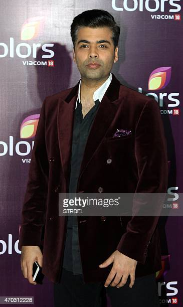 Indian Bollywood film director Karan Johar poses for a photograph during a promotional event in Mumbai on late April 18 2015 AFP PHOTO / STR