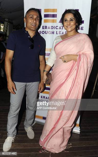 Indian Bollywood film director Rahul Bose and actress Vidya Balan attend the launch of HEAL an NGO to combat child sexual abuse in Mumbai on July 25...
