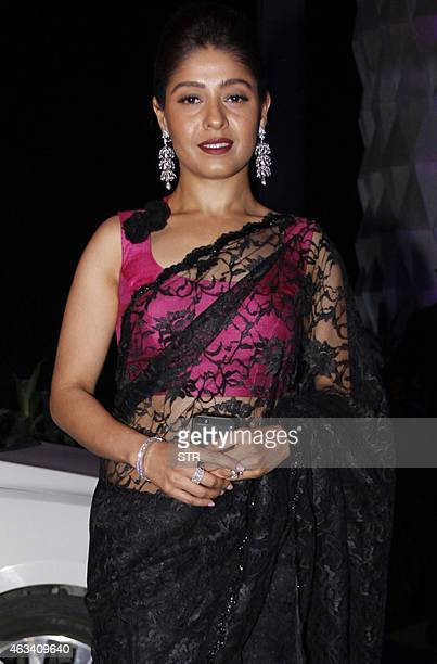 Indian Bollywood film play back singer Sunidhi Chauhan attends the wedding reception of Bollywood film producer Smita Thackeray's son Rahul Thackeray...