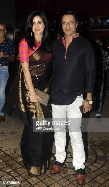 Indian Bollywood film producer Madhur Bhandarka with actress Kirti Kulhari attend a screening of upcoming Hindi film Indu Sarkar in Mumbai on July 27...