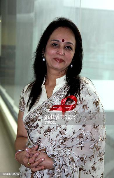 Indian Bollywood film producer Smita Thackeray poses at the launch of 'Red Ribbon campaign' for World AIDS Day organised by 927 Big FM radio station...