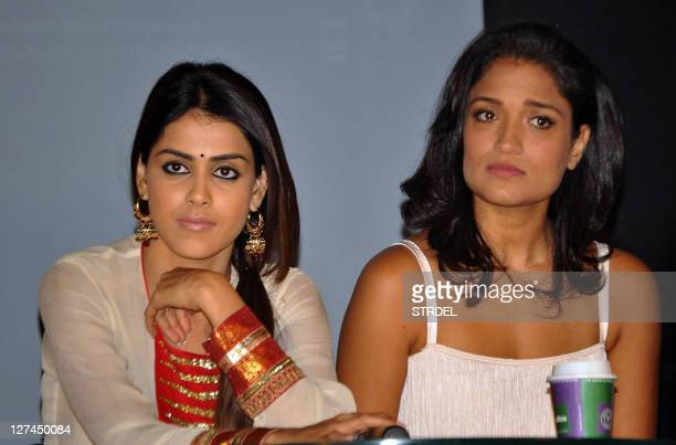 """Indian Bollywood Genelia D'Souza and Sandhya Mridul take part in a promotional event for the forthcoming Hindi action film """"Force"""" in Mumbai late..."""