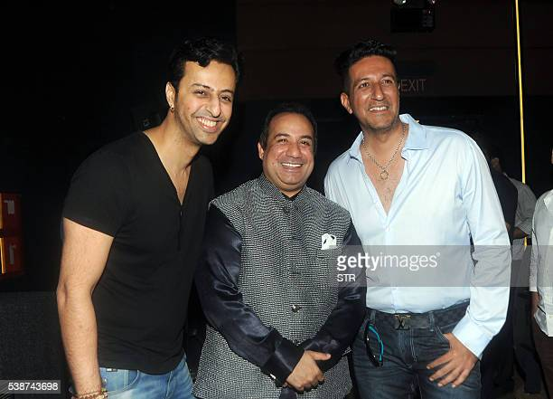 Indian Bollywood Hindi film composer and singers Salim and Sulaiman Merchant and Pakistani singer Rahat Fateh Ali Khan attend the song launch of...