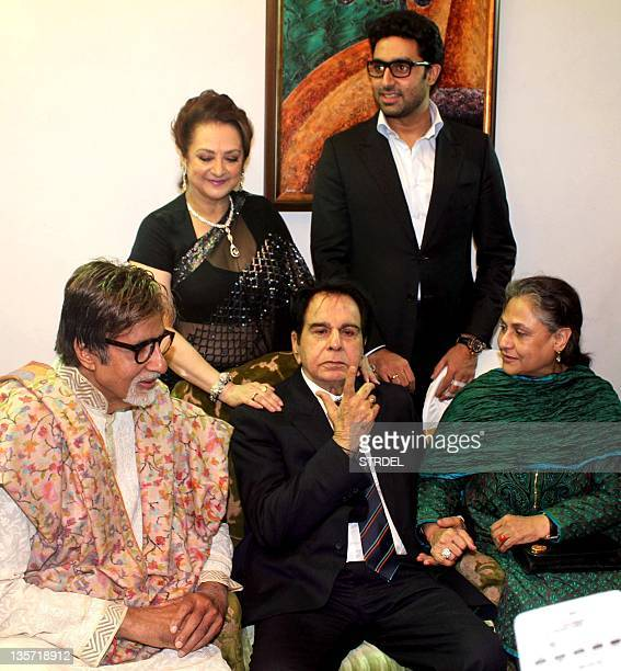 Indian Bollywood legendary actor Dilip Kumar gestures as his wife actress Saira Banu actor Amitabh Bachchan Jaya Bachchan and Abhishek Bachchan pose...