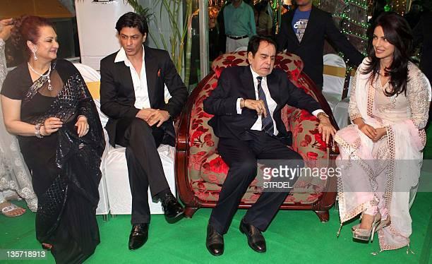 Indian Bollywood legendary actor Dilip Kumar gestures as his wife actress Saira Banu actor Shah Rukh Khan and Priyanka Chopra attend Kumar's 89th...
