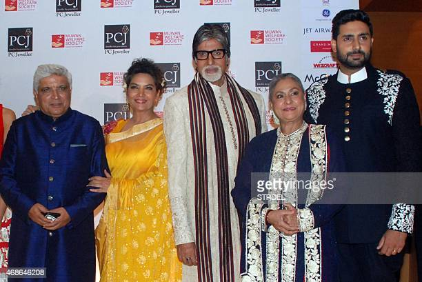 Indian Bollywood lyricist and scriptwriter Javed Akhtar and Bollywood actors Shabana Azmi Amitabh Bachchan Jaya Bachchan and Abhishek Bachchan pose...