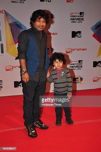 Indian Bollywood music director singer and composer Kailash Kher with his son during the MTV Video Music Awards 2013 at Tulip Star Hotel Juhu Tara...