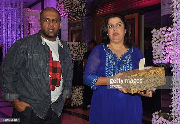 Indian Bollywood music director Vishal and choreographer Farah Khan attend the wedding reception of playback singer Sunidhi Chauhan and musician...