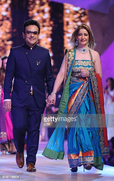 Indian Bollywood musician and singer Adnan Sami showcases a creation during a charity fashion show in Mumbai on late March 20 2016 / AFP / STR