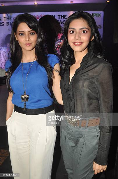 Indian Bollywood personalities Aamna Sharif and Umang Jain pose during a promotional event for the forthcoming Hindi film 'Shakal Pe Mat Ja' in...