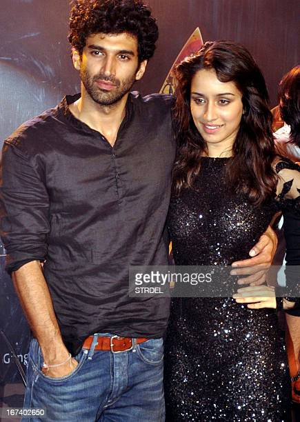 Indian Bollywood personalities Aditya Roy Kapoor and Shraddha Kapoor pose during a promotional event for the Hindi film Aashiqui 2 in Mumbai on April...