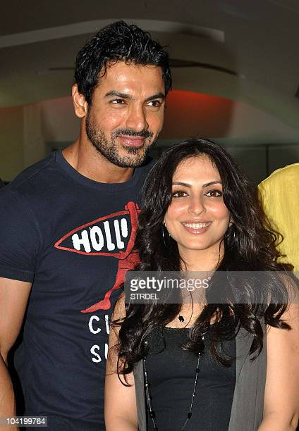 Indian Bollywood personalities John Abraham and Pakhi pose during a promotional event for the forthcoming Hindi movie Jhootha Hi Sahi in Mumbai on...