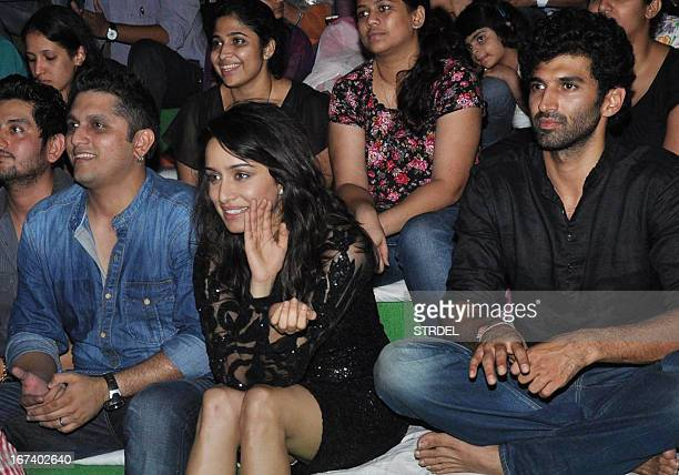 Indian Bollywood personalities Mohit Suri Shraddha Kapoor and Aditya Roy Kapoor attend a promotional event for the Hindi film 'Aashiqui 2' in Mumbai...