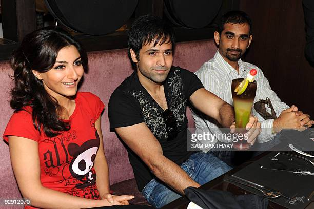 Indian Bollywood personalities Soha Ali Khan , Emraan Hashmi and director Kunal Deshmukh pose at the Grand Bhagwati's Cafe Piano, in Ahmedabad on...