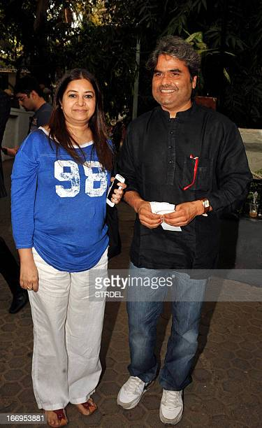 Indian Bollywood personalities Vishal Bhardwaj and his wife Rekha Bhardwaj arrive to watch the play 'Paansa' directed by Salim Arif and written by...