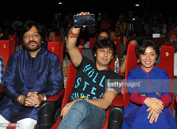Indian Bollywood play back singers Roopkumar Rathod Sonu Nigam and Sunidhi Chauhan pose during the trailer and music launch of the upcoming...