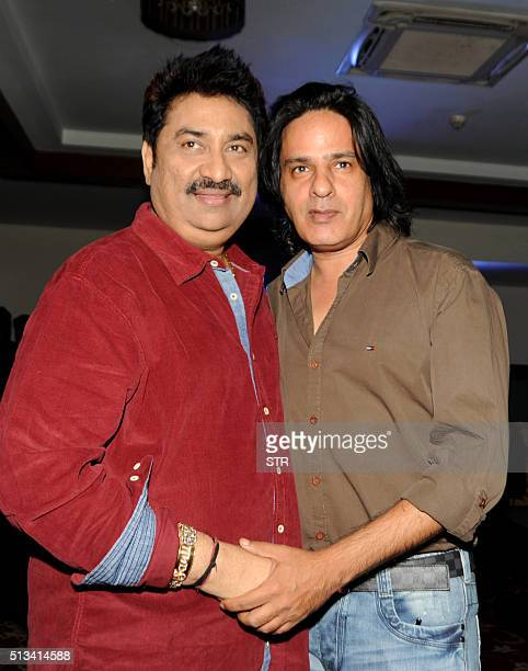 Indian Bollywood playback singer Kumar Sanu and actor Rahul Roy attend an event in honour of Bollywood music director and singer Anu Malik at 'The...