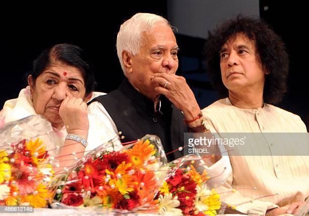 Indian Bollywood playback singer Lata Mangeshkar classical singer Pt Pandharinath Kolhapure and tabla player Zakir Hussain speak during the '72nd...