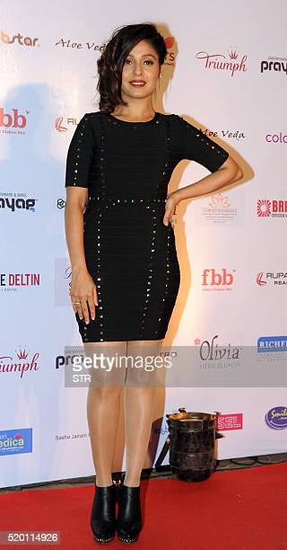 Indian Bollywood playback singer Sunidhi Chauhan poses as she attends Femina Miss India Grand Finale 2016 in Mumbai late April 9 2016 / AFP / STR
