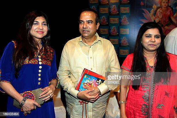 Indian Bollywood playback singers Alka Yagnik Suresh Wadkar and Sadhana Sargam pose during the launch of Bollywood actress Hema Malini's first album...